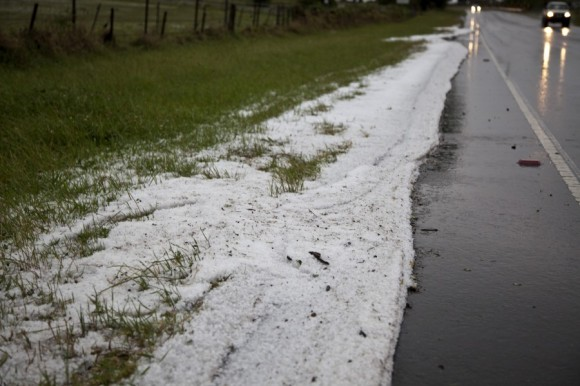hail swept into drifts onto the road side